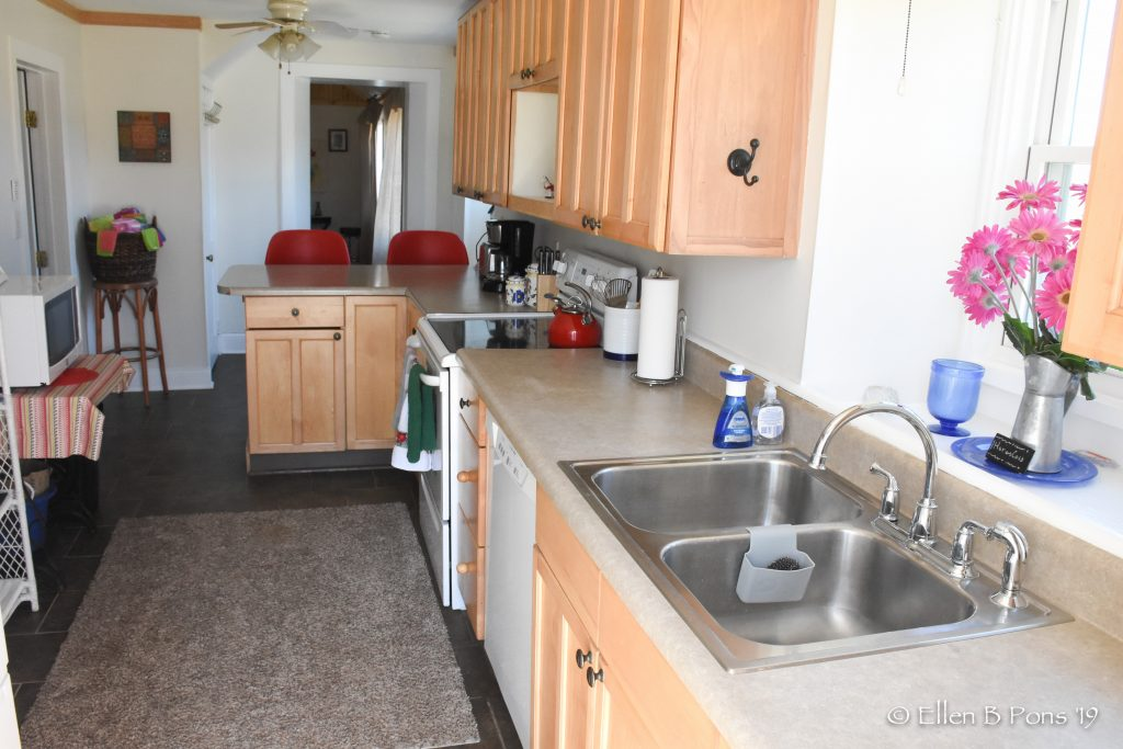 Galley style kitchen is fully equipped for cooking and entertaining.