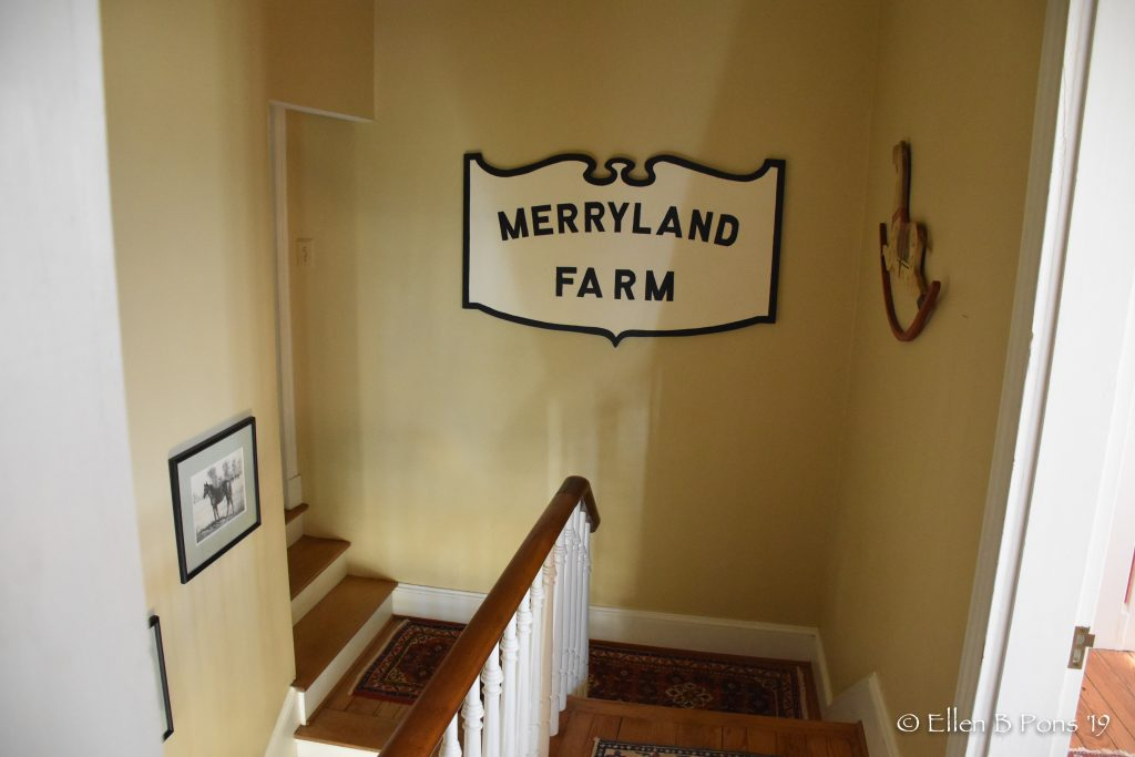 The central staircase features this recreated vintage sign by Lisa Pons