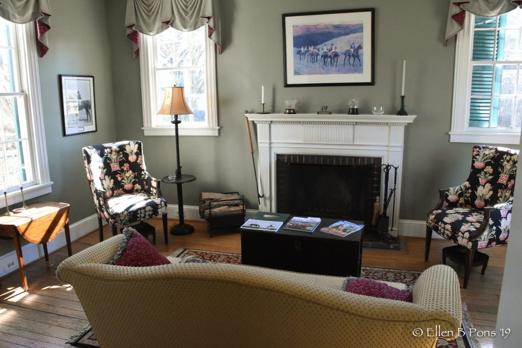 The formal living room is a shared space for clients visiting the farm.